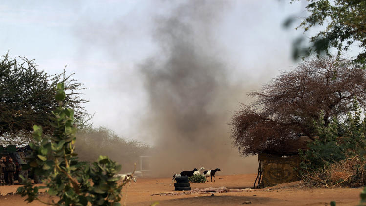 French soldiers detonate three grenades in a controlled explosion in  the area where a suicide bomber exploded at the entrance of  Gao, northern Mali, Sunday  Feb. 10, 2013. It was the second time a suicide bomber targeted the Malian army checkpoint in three days.  (AP Photo/Jerome Delay)