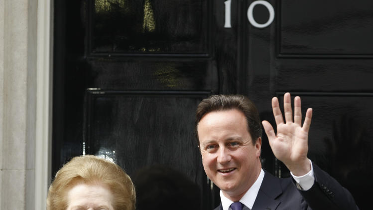 "FILE - This is a Tuesday, June, 8, 2010 file photo of  Britian's Prime Minister David Cameron poses with former Prime Minister Margaret Thatcher on the doorstep of 10 Downing Street  in London.  Ex-spokesman Tim Bell says that Thatcher has died. She was 87. Bell said the woman known to friends and foes as ""the Iron Lady"" passed away Monday morning, April 8, 2013. (AP Photo/Alastair Grant,File)"