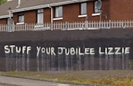 Anti-monarchy graffiti pictured on a wall in west Belfast, Northern Ireland. Queen Elizabeth II made a historic gesture in Northern Ireland&#39;s peace process when she shook the hand of former IRA commander Martin McGuinness