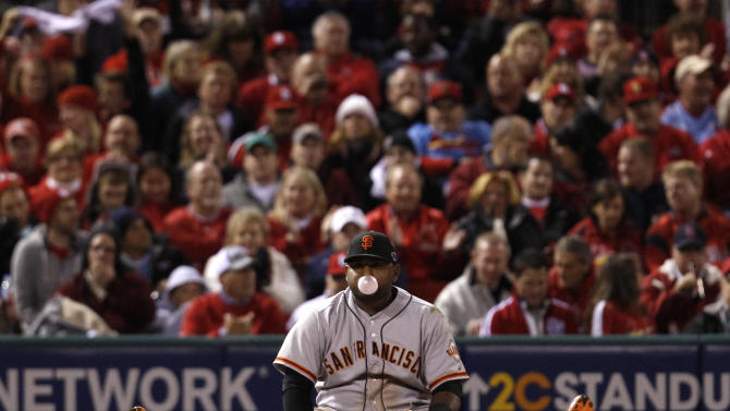 San Francisco Giants third baseman Sandoval sits on the ground after making a diving stop but was late on the throw to get St. Louis Cardinals Craig at first in the seventh inning during Game 4 of their MLB NLCS playoff baseball series in St. Louis