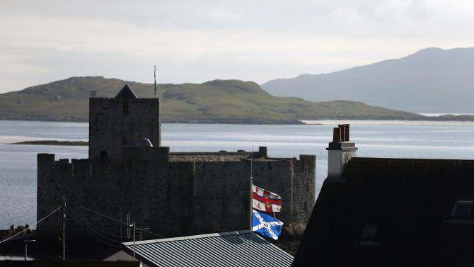 "A ""Yes"" campaign flag flies from a building near Kisimul Castle on the Island of Barra in the Outer Hebrides"