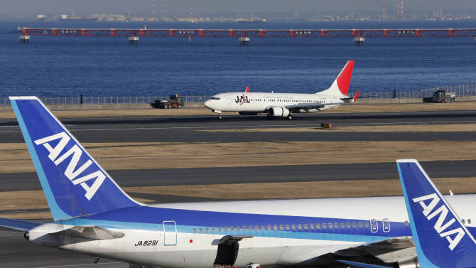 In this Jan. 30, 2013 photo, All Nippon Airways passenger planes park on the tarmac of Haneda Airport in Tokyo.  Japan's All Nippon Airways is prepared to recoup from Boeing whatever damages it suffers from flight cancellations and other costs caused by the worldwide grounding of 787 jets, a senior executive said Thursday, Jan. 31, 2013.  (AP Photo/Shizuo Kambayashi)