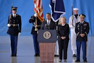US President Barack Obama (C) speaks as Secretary of State Hillary Clinton looks on during the transfer of remains ceremony marking the return to the US of the remains of the four Americans killed in an attack this week in Benghazi, Libya, at the Andrews Air Force Base in Maryland