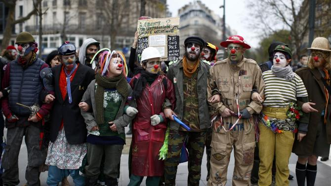 Environmentalists gather during a protest near the Place de la Republique after the cancellation of a planned climate march following shootings in the French capital, ahead of the World Climate Change Conference 2015 (COP21), in Paris