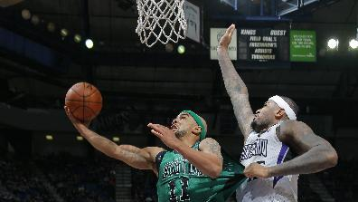 Kings hold off short-handed Celtics 105-98