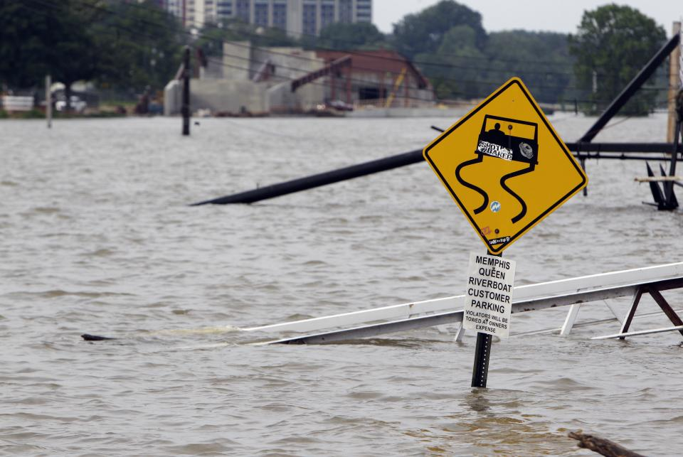 A ramp leading to the Memphis Queen riverboat and its parking area are surrounded by floodwater Saturday, May 7, 2011, in Memphis, Tenn. Communities all along the banks of the Mississippi are keeping a close eye on the river's rise with the crest in Memphis not expected until Wednesday. (AP Photo/Jeff Roberson)