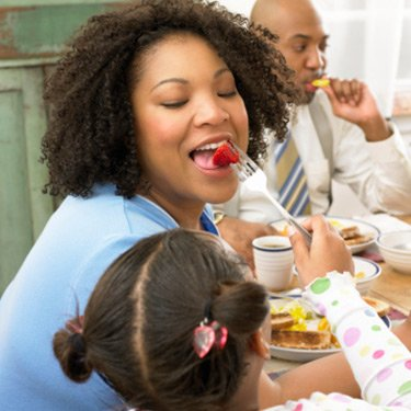 Daughter-feeding-her-mother-a-strawberry_web