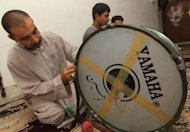 Louai prepares his drum before heading out into the streets of Baghdad&#39;s Sadr City. A combination of the poor security in the city along with the restrictions on movement even for mousaheratis has led to a halving of their numbers compared to last year