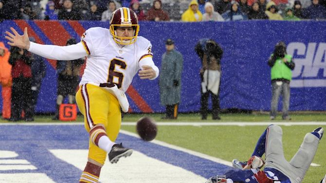 Washington Redskins punter Sav Rocca (6) kicks the ball away from New York Giants' Julian Talley (19) during the first half of an NFL football game on Sunday, Dec. 29, 2013, in East Rutherford, N.J