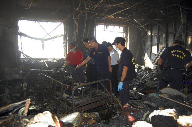 In this photo released by Tainan Fire Department, investigation teams search for possible causes of an early morning fire that swept through the Hsinying Hospital&#39;s nursing ward, early Tuesday, Oct. 23, 2012, in the southern city of Tainan, Taiwan. Officials say the fire has killed 12 patients and injured 70 others. (AP Photo/Tainan Fire Department) EDITORIAL USE ONLY