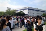 Image provided by China Labor Watch on September 19 shows thousands of workers at a Singapore-owned Flextronics Technology plant in Shanghai on strike against a plan to move the factory