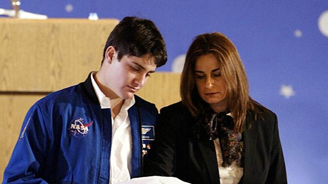 FILE - In this  Feb. 10, 2003 file photo, Rona Ramon, right, and Assaf Ramon, left, widow and eldest son of Israel's first astronaut Ilan Ramon, pay their respects beside his coffin during a memorial service at Ben Gurion International Airport outside Tel Aviv. Ten years after the loss of her husband followed by the loss of her son Assaf six years later,  Ramon, 48, said she has slowly tried to rebuild her life, leading a foundation formed in memory of her husband and son and counseling others who are coping with tragedy.(AP Photo/ Paul Hanna, Pool, File)