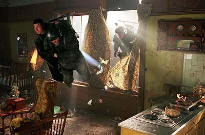 Anderton ( Tom Cruise ) and the precrime cops crash into a tenement window in 20th Century Fox's Minority Report