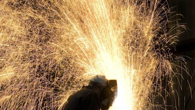 FILE - In this Oct. 9, 2007 file photo, an ironworker in Lynchburg, Va. welds steel destined for New York's One World Trade Center building. (AP Photo/Mark Lennihan, File)