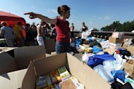Russians pack boxes of donated clothing, food and household items at a humanitarian aid collection point in Moscow. Pro-government and opposition newspapers have showed rare unanimity in saying the authorities badly failed local inhabitants in the worst-hit town of Krymsk
