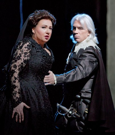 In this Feb. 14, 2013 photo provided by the Metropolitan Opera, Anna Smirnova plays Ebolige and Dmitri Hvorostovsky as Rodrigo during a dress rehearsal of Don Carlo at the Metropolitan Opera in New York. (AP Photo/Metropolitan Opera, Ken Howard