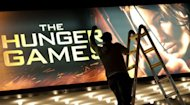 Teen action film phenomenon &quot;The Hunger Games&quot; stayed on top of the North American box office for a second weekend, easily besting tales of Greek gods and Snow White, industry data showed Monday