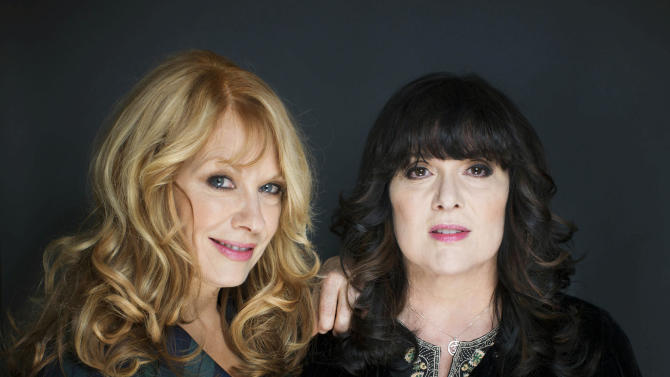 """FILE - This Oct. 1, 2012 file photo shows sisters Ann, left, and Nancy Wilson from Heart in New York. The eclectic group of rockers Rush and Heart, rappers Public Enemy, songwriter Randy Newman, """"Queen of Disco"""" Donna Summer and bluesman Albert King will be inducted into the Rock and Roll Hall of Fame next April in Los Angeles. The inductees were announced Tuesday by 2012 inductee Flea of The Red Hot Chili Peppers at a news conference in Los Angeles. (Photo by Victoria Will/Invision/AP Images)"""