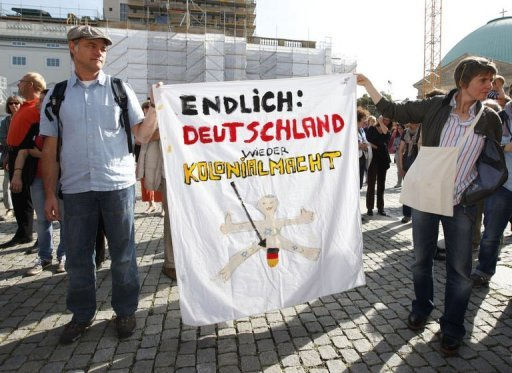 "<p>Protesters hold a banner that reads "" Finally: Germany back to colonial power"" during a demonstration for the religious right of circumcision at Bebelplatz in Berlin. Around 500 mainly Jewish but some Christian and Muslim protesters have gathered in Berlin to demand the right to circumcision after a disputed court ruling in Germany outlawing the rite.</p>"