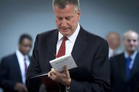 New York City Mayor Bill de Blasio makes last second changes to his notes as he walks into a news conference about Dr. Craig Spencer after it was confirmed that Spencer has contracted Ebola, in New York