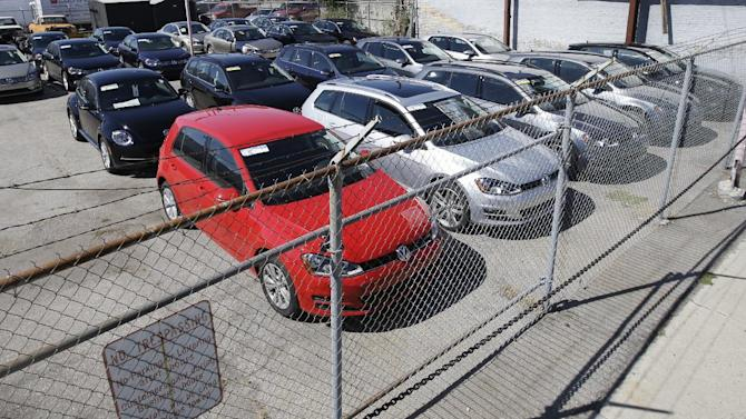 FILE - In this Sept. 23, 2015 file photo, Volkswagen diesels sit behind a security fence on a storage lot near a VW dealership in Salt Lake City. According to an Associated Press statistical and computer analysis, the software that the company admitted using to get around government emissions limits allowed VWs to spew enough pollution to kill somewhere between 16 and 94 deaths over seven years _ with the annual count increasing more recently as more of the diesels were on the road. (AP Photo/Rick Bowmer, File)