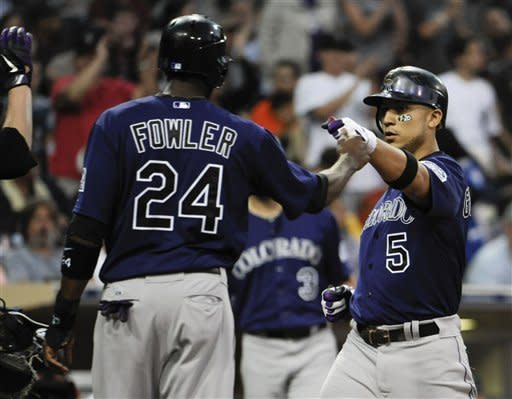 Padres power past Rockies 9-5