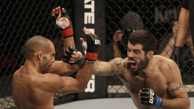 Matt Brown, right, punches Mike Swick in the second round during a welterweight mixed martial arts bout at a UFC on FOX event in Seattle, Saturday, Dec. 8, 2012. Brown won by knockout in the second round. (AP Photo/Jeff Chiu)