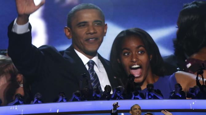 President Barack Obama and his daughter Malia wave after President Obama's speech to the Democratic National Convention in Charlotte, N.C., on Thursday, Sept. 6, 2012. (AP Photo/Charles Dharapak)