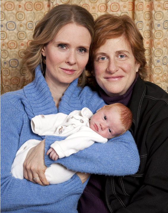 In this photo taken by Brian Ach and released by ID-PR, actress Cynthia Nixon, left, and Christine Marinoni pose with their son Max on Friday, Feb. 11, 2011 in New York. Max was born on Feb. 7. (AP Ph