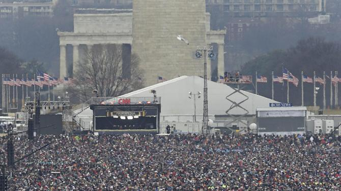 Crowds fill the National Mall to watch the ceremonial swearing-in of President Barack Obama at the U.S. Capitol during the 57th Presidential Inauguration in Washington, Monday, Jan. 21, 2013. (AP Photo/J. Scott Applewhite)