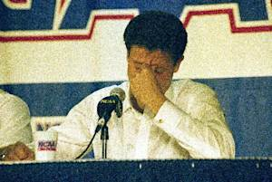 """FILE - In this March 28, 1992, file photo, Kentucky head coach Rick Pitino reacts during the end of the East Regional Final NCAA college basketball game news conference following their 104-103 overtime loss to Duke in Philadelphia. For the first time since Christian Laettner's improbable buzzer-beater, head coaches Mike Krzyzewski and Pitino are meeting in the regional finals of the NCAA tournament. Pitino is across the state in Louisville these days, but that doesn't lessen the drama of their long-awaited """"rematch."""" (AP Photo/Charles Rex Arbogast, File)"""