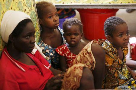 A mother and her children rescued from Boko Haram in Sambisa forest rest in the domitory at the Malkohi camp for Internally Displaced People in Yola