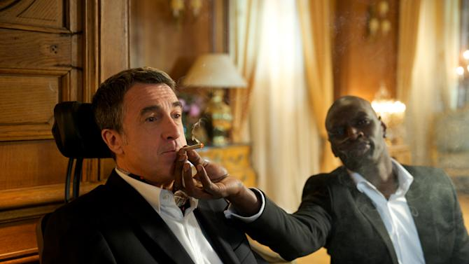 """In this film image released by The Weinstein Company, Francois Cluzet, left, and Omar Sy are shown in a scene from """"The Intouchables."""" (AP Photo/The Weinstein Company, Thierry Valletoux)"""