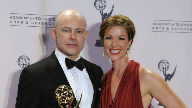 "Rob Corddry and his wife Sandra Corddry pose backstage with the award for outstanding special class: short-format live-action entertainment programs for ""Children's Hospital"" at the 2012 Creative Arts Emmys at the Nokia Theatre on Saturday, Sept. 15, 2012, in Los Angeles. (Photo by Chris Pizzello/Invision/AP)"