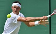 Australian Bernard Tomic (pictured in June) booked a third-round spot at the ATP Cincinnati Masters on Tuesday, the teen's 6-4, 6-3 defeat of American Brian Baker settling up a likely meeting with Roger Federer