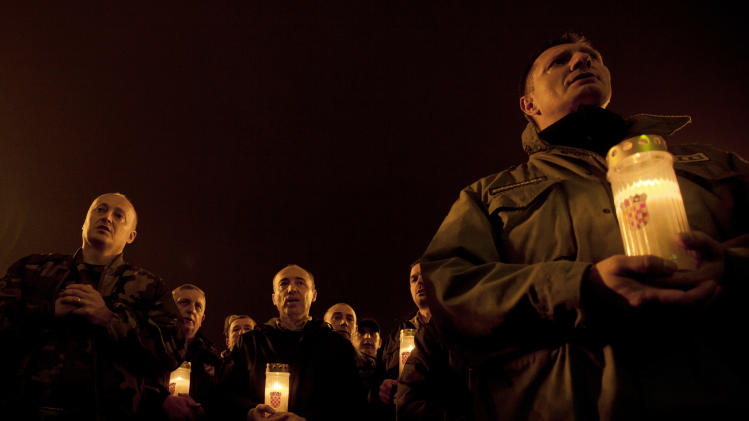 Croatian war veterans hold candles during a vigil for Croatian generals Gotovina and Markac, in Zagreb, Croatia, Thursday, Nov. 15, 2012.Thousands of Croatians on Thursday attended Masses and candlelight vigils for their hero, Gen. Ante Gotovina, as they anxiously awaited the outcome of his appeal against a war crimes verdict at a U.N. tribunal.(AP Photo/Nikola Solic)