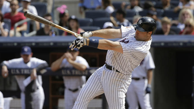 New York Yankees first baseman Mark Teixeira follows through on a lead-off double against the Tampa Bay Rays during the ninth inning of a baseball game, Saturday, July 4, 2015, in New York. The Yankees won 3-2. (AP Photo/Julie Jacobson)