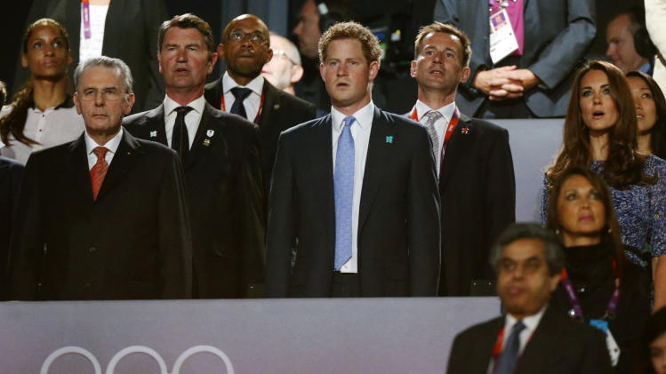President of the International Olympic Committee Jacques Rogge, left, Britain's Prince Harry, center, and Britain's Catherine, Duchess of Cambridge, right, sing the British national anthem during the Closing Ceremony at the 2012 Summer Olympics, Sunday, Aug. 12, 2012, in London. (AP Photo/Matt Dunham)
