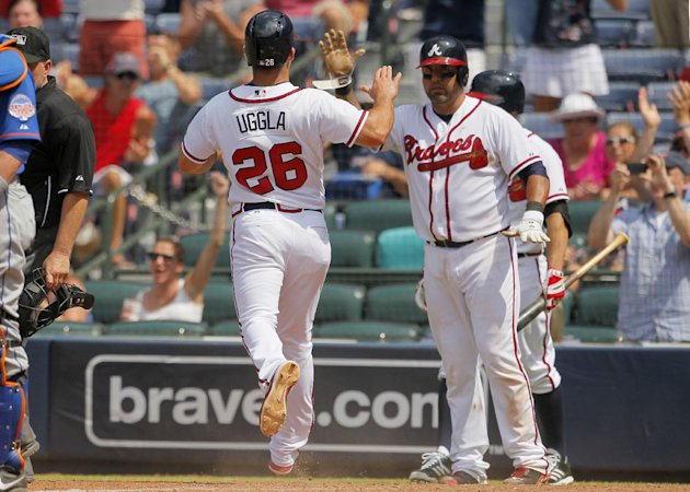 Atlanta Braves catcher Gerald Laird (11) scores along with second baseman Dan Uggla (26) in the eighth inning in the first baseball game of the doubleheader against the New York Mets Tuesday, June 18,