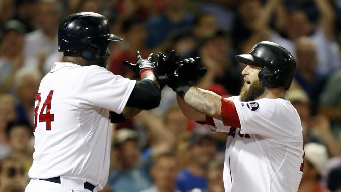 CORRECTS PERSON WHO HIT HOME RUN TO MIKE NAPOLI, INSTEAD OF JONNY GOMES - Boston Red Sox's Mike Napoli, right, celebrates his three-run home run with David Ortiz, left, who scored on the homer, in the third inning of a baseball game against the New York Yankees in Boston, Sunday, July 21, 2013. (AP Photo/Michael Dwyer)