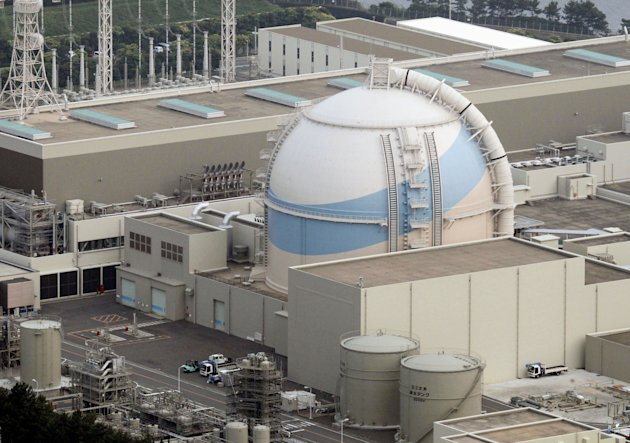 This photo taken in June 2011 shows the No. 3 reactor building of Kyushu Electric Power Co.'s Genkai plant in the town of Genkai, southwestern Japan. Radioactive water leaked inside the nuclear power plant, but the contaminated water did not escape into the environment, the government said Saturday, Dec. 10, 2011. Tetsuya Saito, spokesman for the Nuclear and Industrial Safety Agency, this nation's nuclear regulators, said 1.8 tons of radioactive water leaked inside Genkai, and the cause was still under investigation. The mishap at the reactor is a reminder of safety concerns as this nation battles meltdowns at the tsunami-crippled Fukushima Dai-ichi plant. (AP Photo/Kyodo News) JAPAN OUT, MANDATORY CREDIT, NO LICENSING IN CHINA, FRANCE, HONG KONG, JAPAN AND SOUTH KOREA