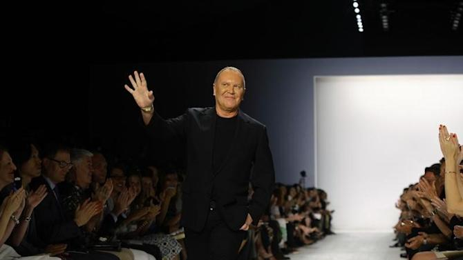 Michael Kors acknowledge the crowd after Spring/Summer 2014 collection during New York Fashion Week