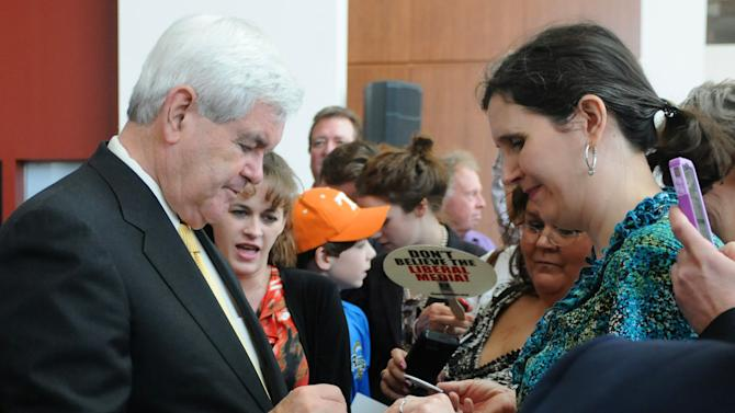 Republican presidential candidate, former House Speaker Newt Gingrich signs an autograph for a supporter after speaking at a rally in Montgomery, Ala., Wednesday, March 7, 2012. (AP Photo/David Bundy)
