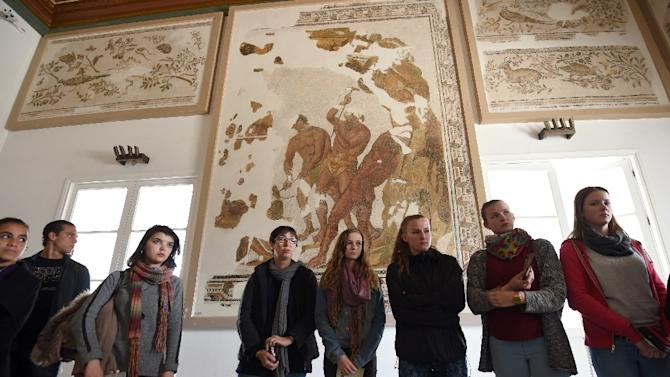 Tourists visit the national Bardo Museum in Tunis during the official re-opening of the tourist site, on March 27, 2015