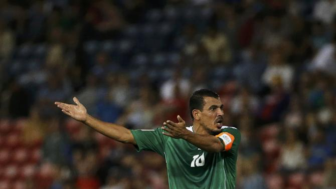 Iraq's Younus Mahmood reacts during their Asian Cup third-place playoff soccer match against UAE at the Newcastle Stadium in Newcastle