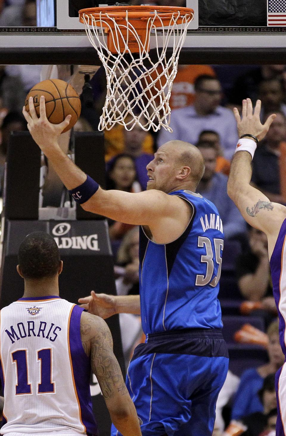 Dallas Mavericks' Chris Kaman drives against the Phoenix Suns during the second half of an NBA basketball game, Thursday, Dec. 6, 2012, in Phoenix. (AP Photo/Matt York)