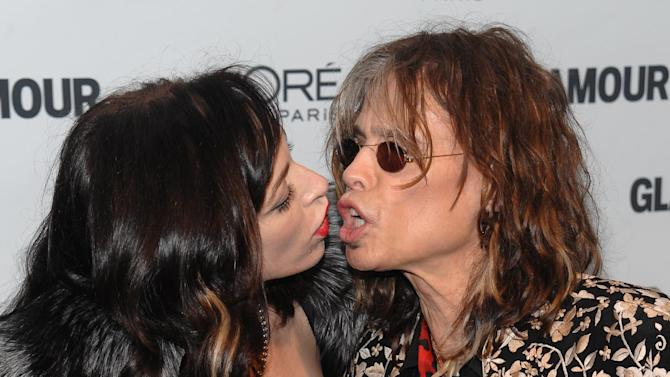 FILE - In this Nov. 9, 2009 file photo, Erin Brady, left, and Steven Tyler of Aerosmith attend the Glamour Magazine 2009 Women of the Year Awards at Carnegie Hall in New York. Tyler's representative confirmed Monday, Jan. 2, 2012, that the Aerosmith frontman is engaged to Erin Brady. (AP Photo/Evan Agostini, FILE)