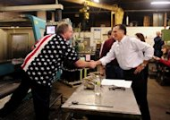 "Republican presidential hopeful Mitt Romney meets a factory worker in New Hampshire. As the US candidates battle it out in the final weeks of the campaign another showdown looms, with the world's largest economy coasting towards a potentially disastrous ""fiscal cliff."""