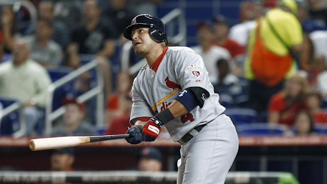 St. Louis Cardinals' Yadier Molina watches his three-run home run during the first inning in a baseball game against the Miami Marlins, in Miami on Tuesday, June 26, 2012. (AP Photo/J Pat Carter)