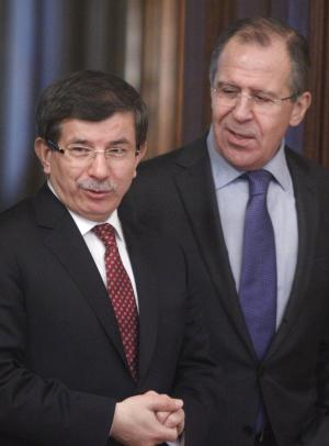Turkish Foreign Minister Ahmet Davutoglu, left, and Russian Foreign Minister Sergey Lavrov are seen during their meeting in Moscow, Russia, Wednesday, Jan. 25, 2012. (AP Photo/Mikhail Metzel)